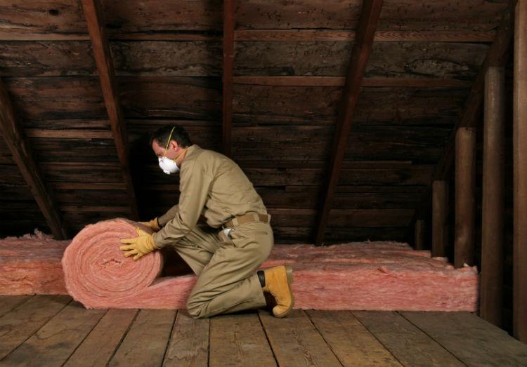 Home Pro Installing Attic Insulation